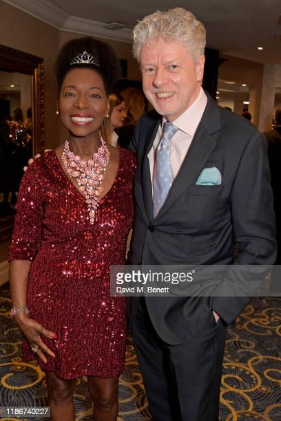 Baroness Floella Benjamin OBE and Keith Taylor attend the Women in Film and TV Awards 2019 at Hilton Park Lane on December 06 2019 in London England