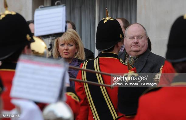 Baroness Helen Newlove and Communities Secretray Eric Pickles watch The Royal British Legion Youth Band march through Horse guards Parade in London...