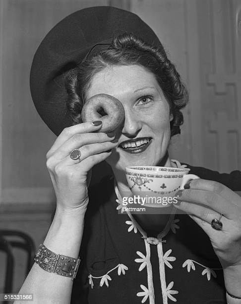 Baroness Irmeia Von Koschembaur refugee from Saxony Germany is shown using a doughnut for a monocle during selection of 'DoughnutDrinking Waitresses'...