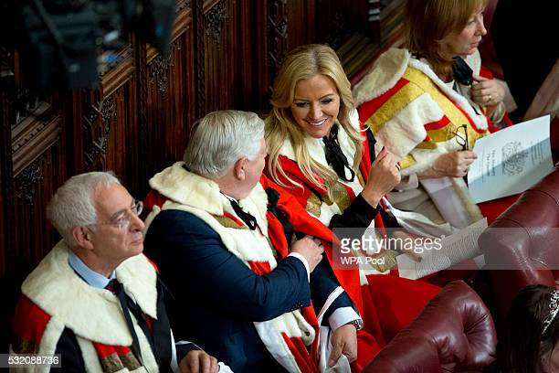 Baroness Michelle Mone sits with members of the House of Lords gathering as Queen Elizabeth II delivers the Queen's Speech from the throne as Prince...