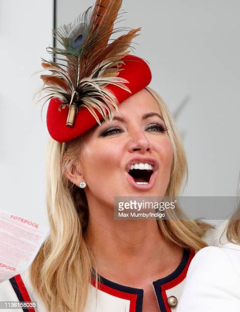 Baroness Michelle Mone watches the racing as she attends day 4 'Gold Cup Day' of the Cheltenham Festival at Cheltenham Racecourse on March 15 2019 in...