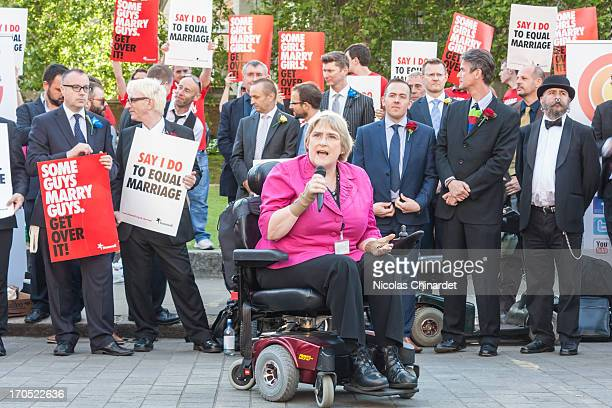 Baroness Sal Brinton talk to the protesters outside Parliament