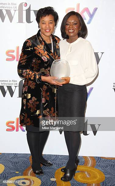 Baroness Scotland and Ronke Phillips attend the Sky Women In Film and Television Awards luncheon at Hilton Park Lane on December 6 2013 in London...