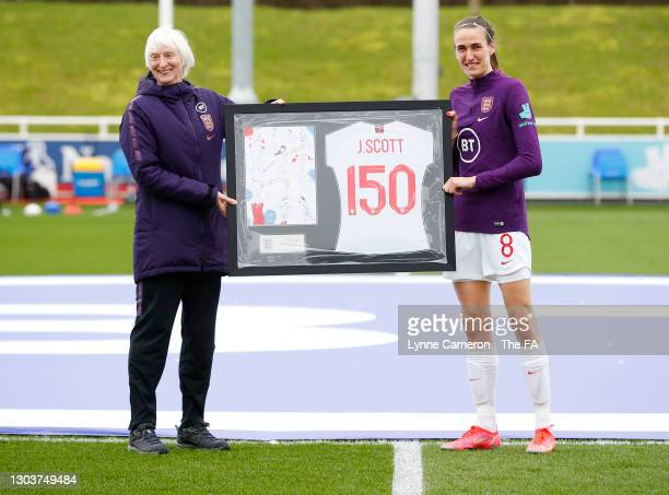 Baroness Sue Campbell, Director of Women's Football for The FA presents Jill Scott of England with a commemorative shirt to mark her 150th cap prior...