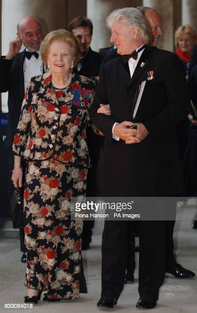 Baroness Thatcher accompanied by event organizer Bruno Peek at the Royal Naval College Greenwich London for a Heroes Dinner celebrating the...