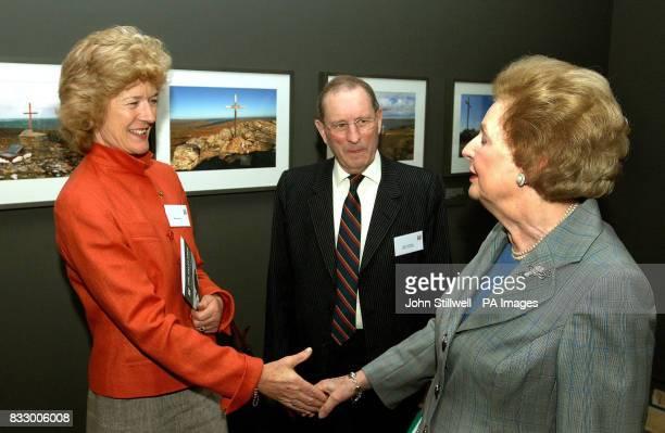 Baroness Thatcher shakes hands with Sarah Jones widow of Lieutenant Colonel H Jones while Falklands veteran Major General Julian Thompson looks on at...