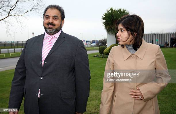 Baroness Warsi talks to Lord Ahmed after arriving at Heathrow airport from Sudan on December 4 2007 in London England British school teacher Gillian...