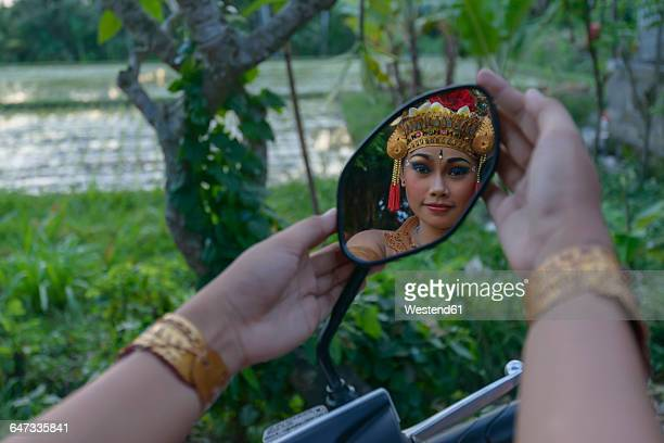 Barong dancer, girl mirrored in mirror