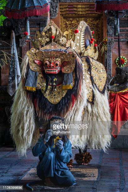 barongan is a character in the mythology dance of bali, indonesia. - shaifulzamri stock pictures, royalty-free photos & images