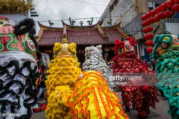 Barongsai dancers perform during Grebeg Sudiro festival infront of Tien Kok Sie temple on February 11 2018 in Solo City Central Java Indonesia Grebeg...