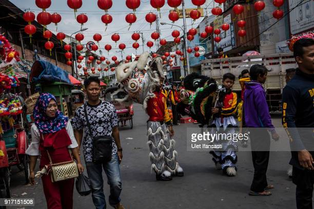Barongsai dancers prepare before perform during Grebeg Sudiro festival infront of Tien Kok Sie temple on February 11 2018 in Solo City Central Java...
