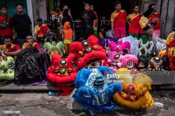 Barongsai dancers prepare before perform during Grebeg Sudiro festival on February 3 2019 in Solo City Central Java Indonesia Grebeg Sudiro festival...