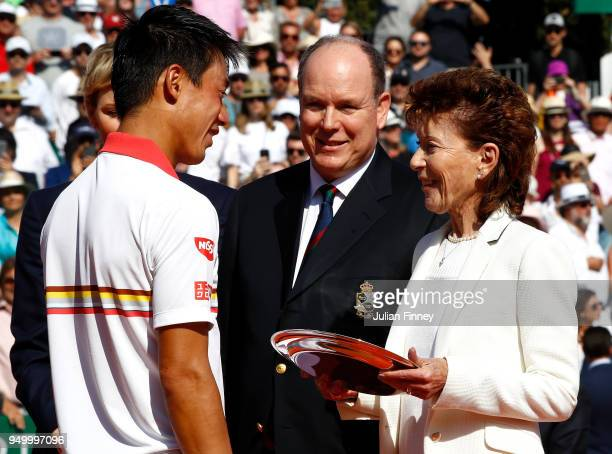 Baronne ElizabethAnn de Massy and Albert II Prince of Monaco with runner up Kei Nishikori of Japan after his loss to Rafael Nadal of Spain during day...