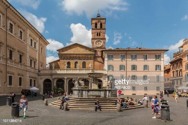 Baroque fountain of Bramante and church of Santa Maria in Trastevere Piazza Santa Maria in Trastevere square district of Trastevere Rome Lazio Italy...