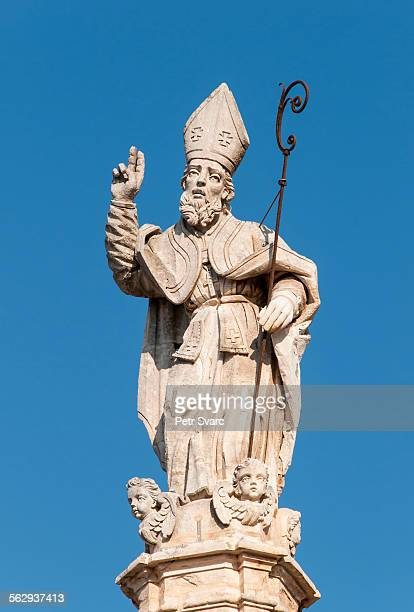 baroque statue on top of the column of saint oronzo, ostuni, apulia, italy - ostuni stock photos and pictures