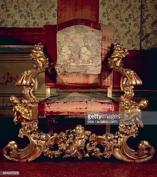 Baroque style carved and gilt wood armchair Throne Room Soragna castle Emilia Romagna Italy 17th century
