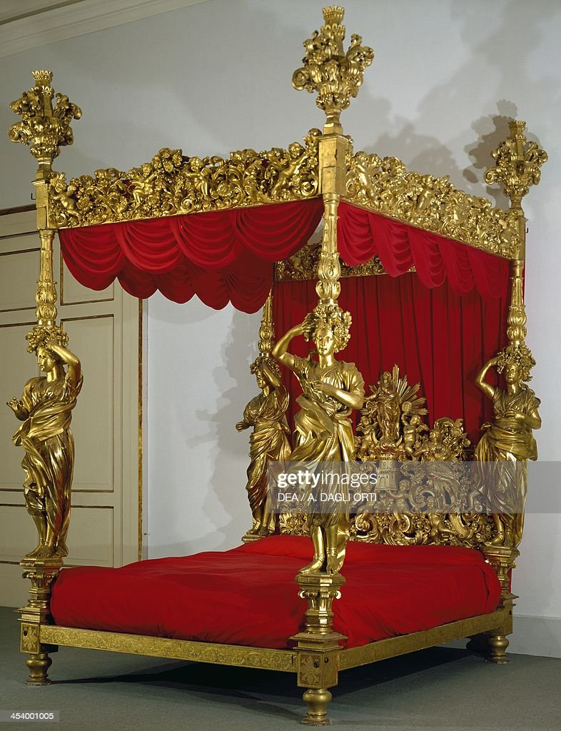 Baroque style carved and gilt wood canopy bed  News Photo & Baroque style carved and gilt wood canopy bed made in Naples. Italy ...