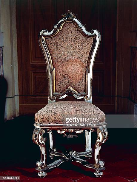 Baroque style chair with upholstered high back carved and gilt wood Soragna castle Emilia Romagna Italy Second half 17th century