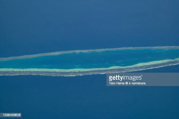 Barque Canada Reef in Sparkly Islands on South China Sea daytime aerial view from airplane