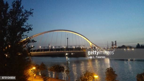 Barqueta bridge at sunset. Seville cityscape