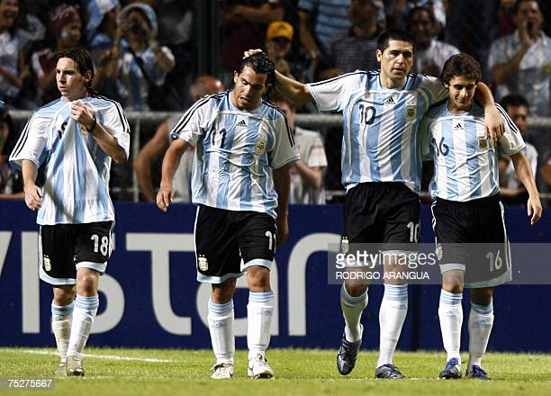 Argentinian Juan Roman Riquelme celebrates with teammates Pablo Aimar Carlos Tevez and Lionel Messi the fourth goal against Peru during their Copa...