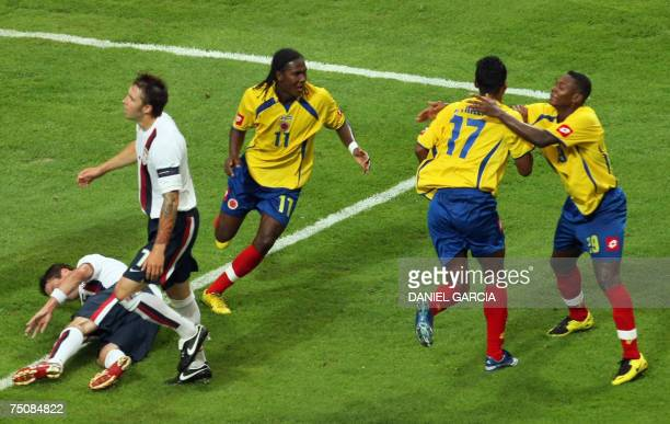 Colombian midfielder Jaime Castrillon celebrates with teammates forward Hugo Rodallega and forward Cesar Valoyes as defenders Drew Moor and Danny...