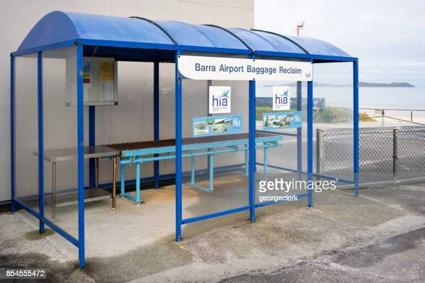 barra airport baggage reclaim - barra scotland stock pictures, royalty-free photos & images
