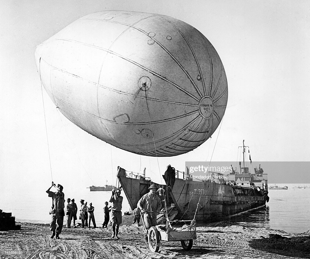 A barrage balloon is released from an English army landing craft near Salerno, Italy, September 1943.