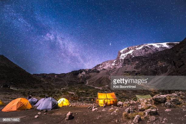barranco camp with milky way at night on the way to mt.kilimanjaro, tanzania - kilimanjaro stock photos and pictures