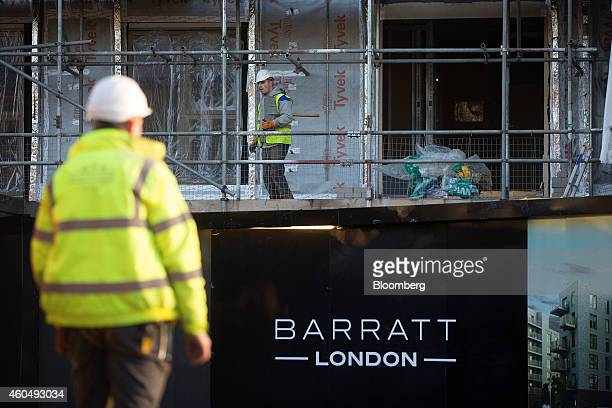 A 'Barratt London' logo sits on a sign outside the 'Catford Green' residential apartment complex as it stands during construction by Barratt...