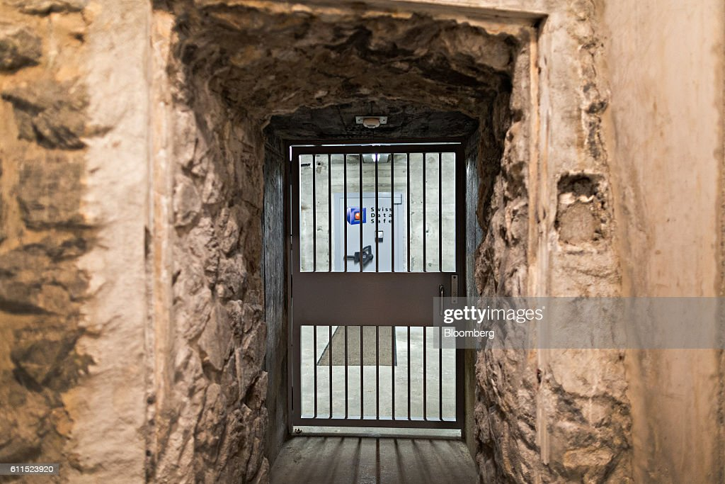 A barred door secures a corridor leading to a vault inside the Swiss Data Safe AG & Bunker Doors Stock Photos and Pictures | Getty Images