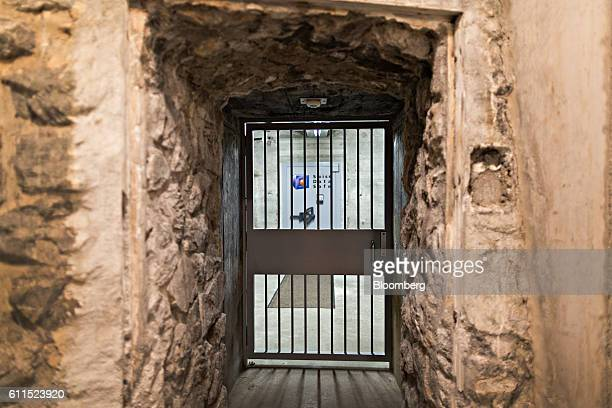 A barred door secures a corridor leading to a vault inside the Swiss Data Safe AG formermilitary bunker secure storage facility in Amsteg Switzerland...