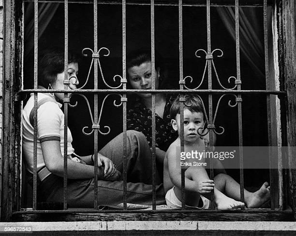 Barred window in East Harlem, New York City, circa 1950.