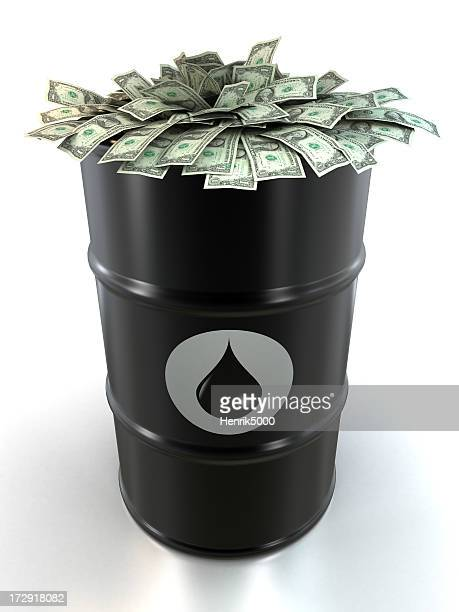 barrel of oil stuffed with dollars - oil barrel stock pictures, royalty-free photos & images