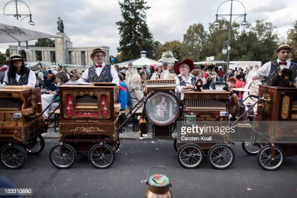 Barrel organ players from the german town Dortmund play near Brandenburg Gate to celebrate German Unity Day on October 3 2012 in Berlin Germany The...