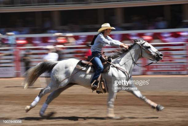 A barrel racer competes in the finals at the Calgary Stampede on July 15 2018 at Stampede Park in Calgary AB