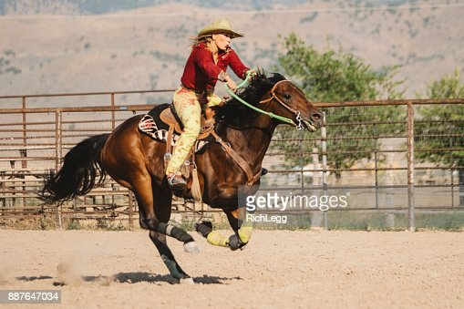 Barrel Racing Cowgirls in a Rodeo
