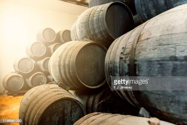 barrels for whiskey or wine stacked in the cellar - jerez de la frontera stock pictures, royalty-free photos & images
