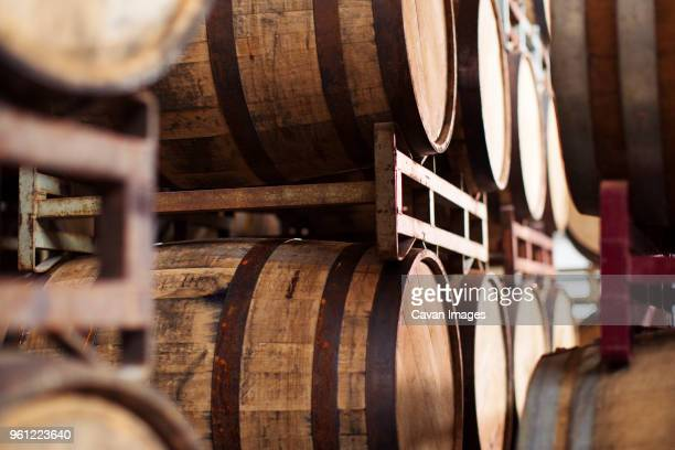 barrels in rack at brewery - stahlfass stock-fotos und bilder