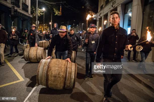 Barrels of Beaujolais Nouveau wine are rolled by winegrowers on November 15 2017 in the streets of Lyon France during the official launch of the...