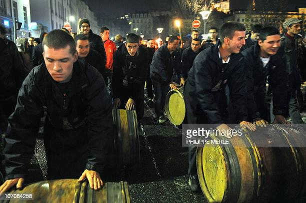 Barrels of Beaujolais Nouveau wine are rolled by winegrowers on November 17 2010 in Center Lyon eastern France during the 2010 vintage Beaujolais...
