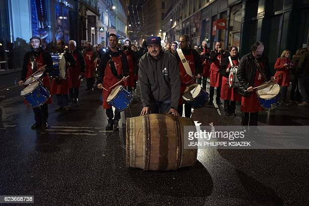 Barrels of Beaujolais Nouveau wine are rolled by winegrowers on November 17 2016 in the streets of Lyon France during the official launch of the...