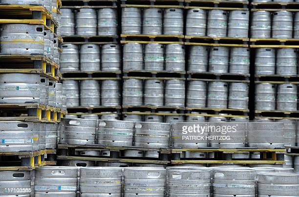 Barrels of beer are displayed on ranges at the Dutch brewer Heineken factory on June 7 2011 in Schiltigheim eastern France during an official visit...