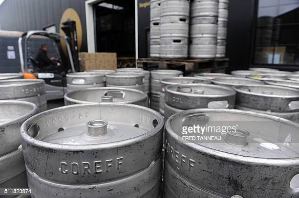 Barrels of beer are stocked on February 22 2016 in the Coreff brewery based in CarhaixPlouguer western of France / AFP / FRED TANNEAU