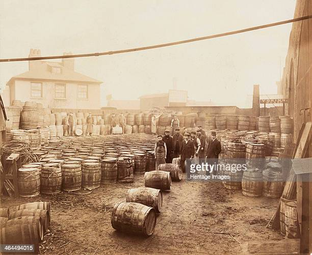 Barrels of Ebano bitumen stored at Elizabeth Wharf, Limehouse, London, c1900. The Ebano Oil Company imported bitumen from Mexico.