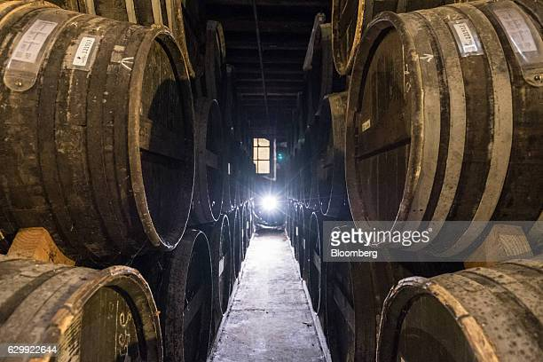 Barrels of Remy Martin fine champagne cognac are laid to age in the Isly cellar at the Remy Cointreau SA headquarters in Cognac France on Friday Dec...