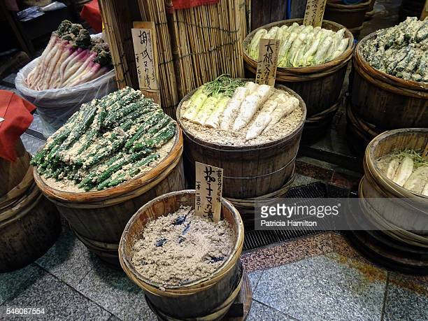 Barrels of root vegetables being fermented.