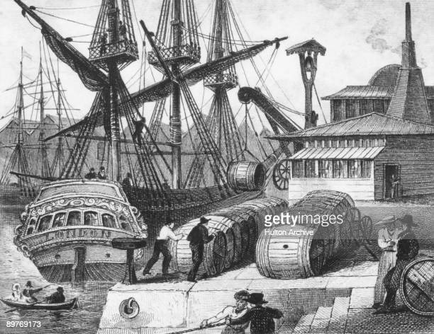 Barrels of sugar from the West Indies are unloaded from a ship at Bristol Quay England circa 1825
