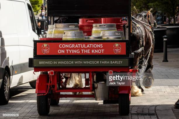 Barrels of Windsor Knot a beer to commemorate the upcoming Royal Wedding are carted by horse ahead of the wedding of Prince Harry and his fiance US...
