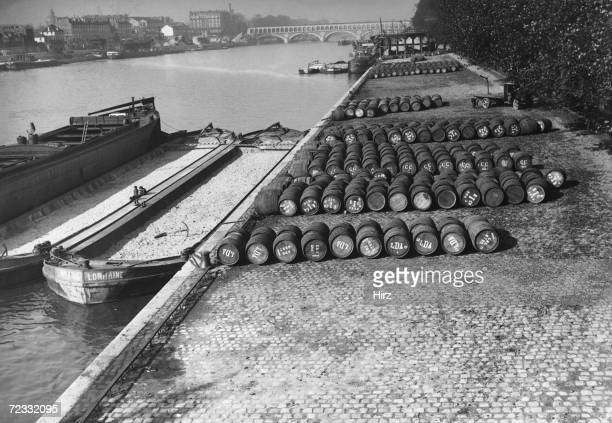 Barrels of wine at the side of the Seine in Bercy Paris awaiting transportation to New York circa 1910